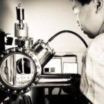 Trinity Crann Science researcher working on device, photographed by industrial photographer John Jordan
